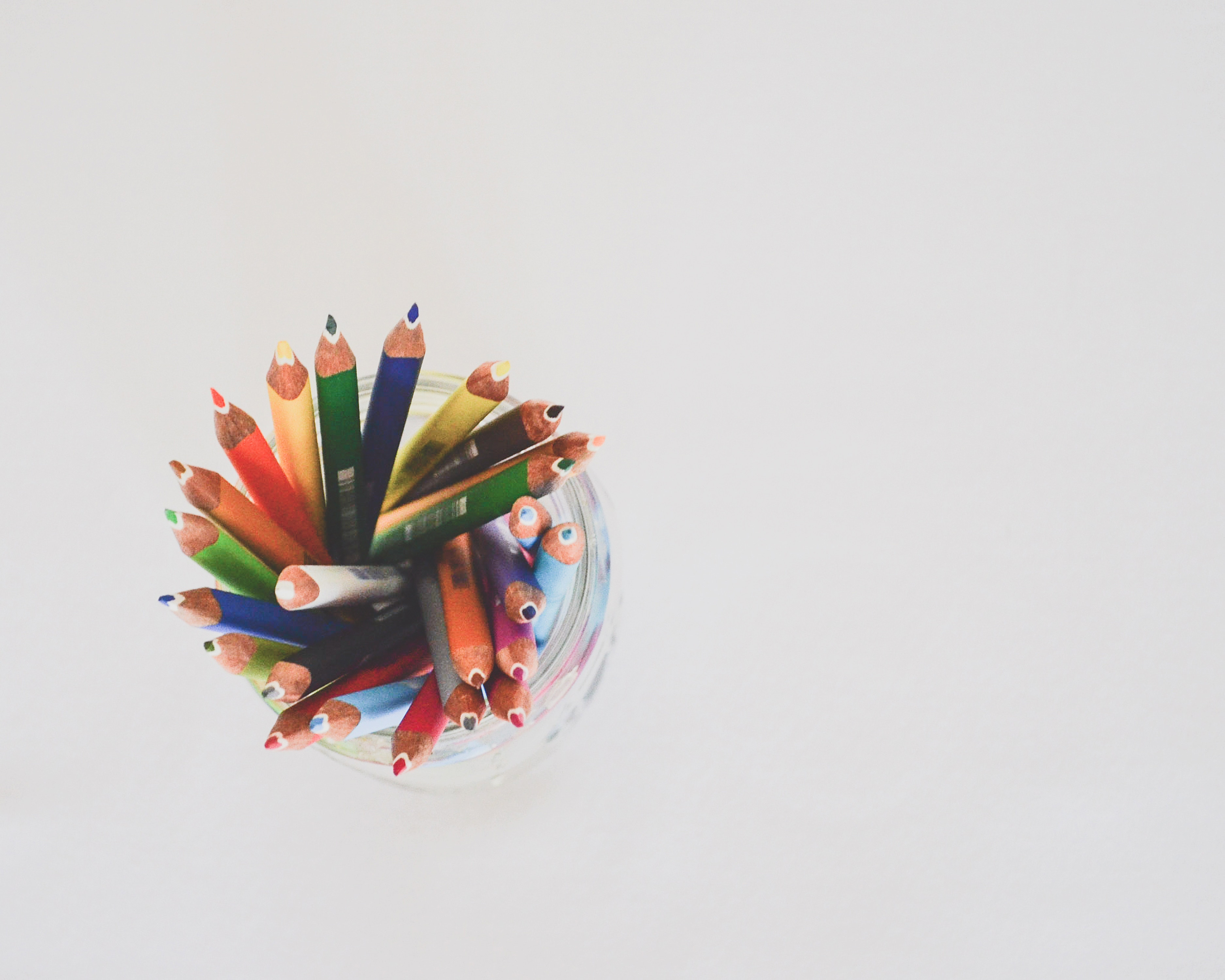 aerial view of a jar of pencil crayons