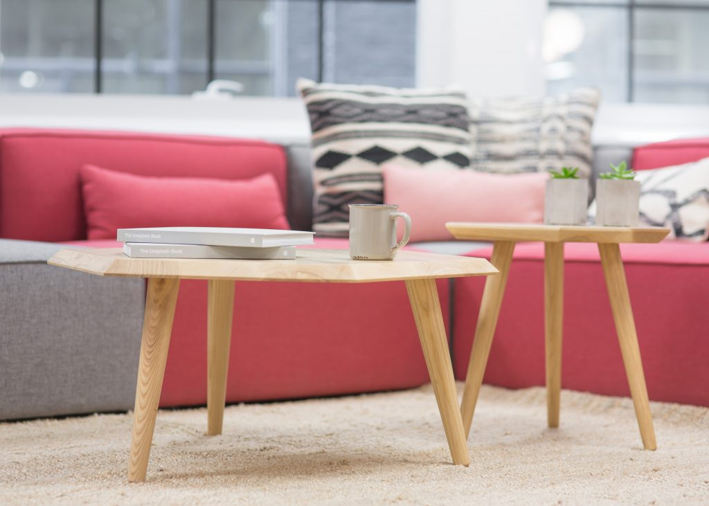 shallow focus photo of couch with side tables
