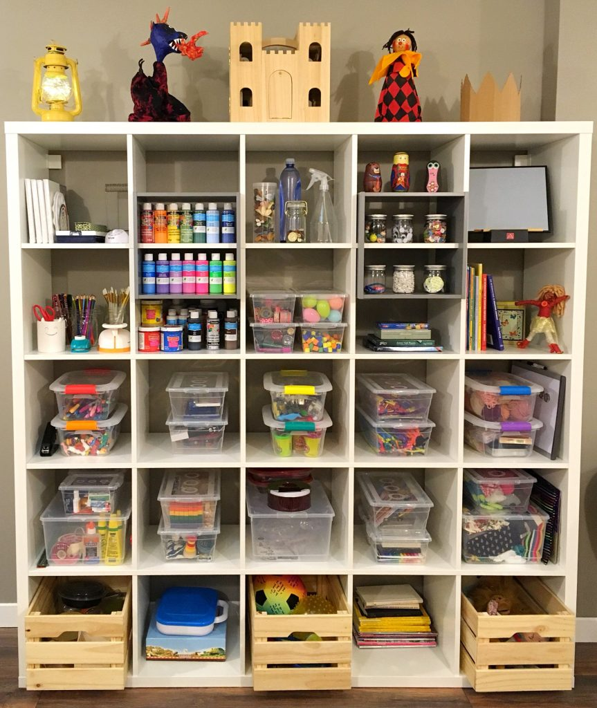 Shelf of art supplies and toys