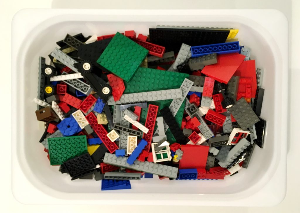 aerial view of white bin filled with LEGO pieces