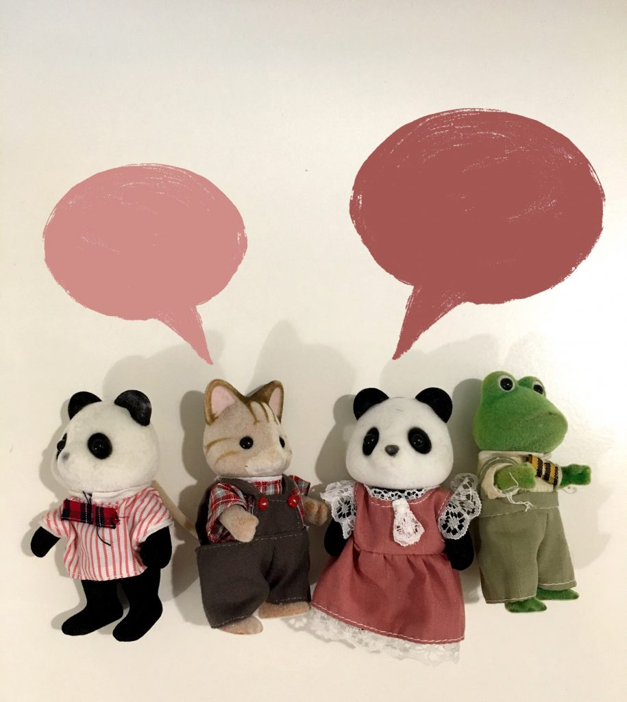 animal toys with speech bubbles above them
