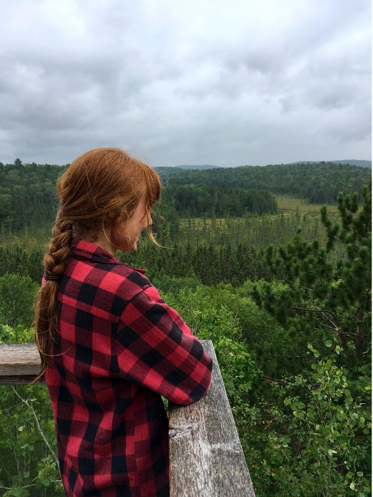 Woman overlooking forested view