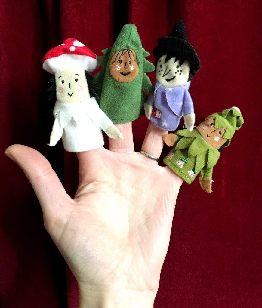finger puppets on a hand
