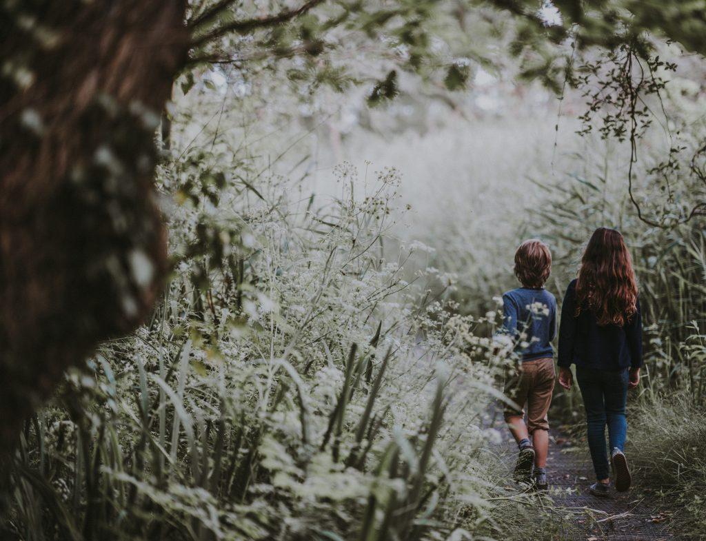 two children walking outside