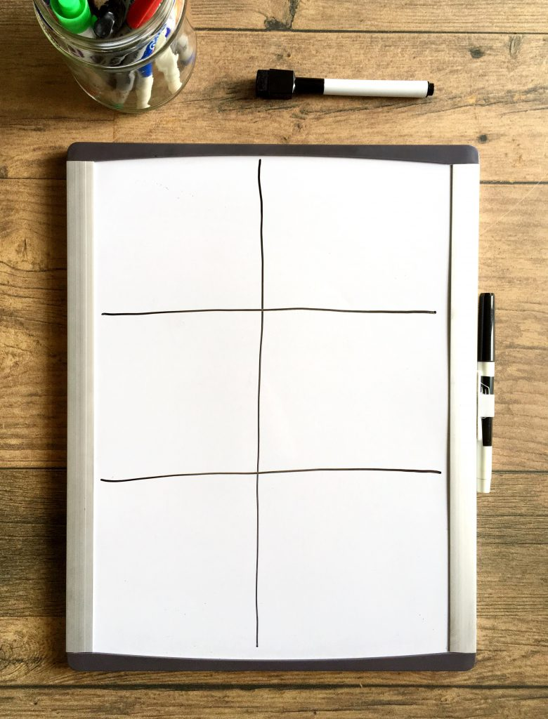 small whiteboard divided into six square sections