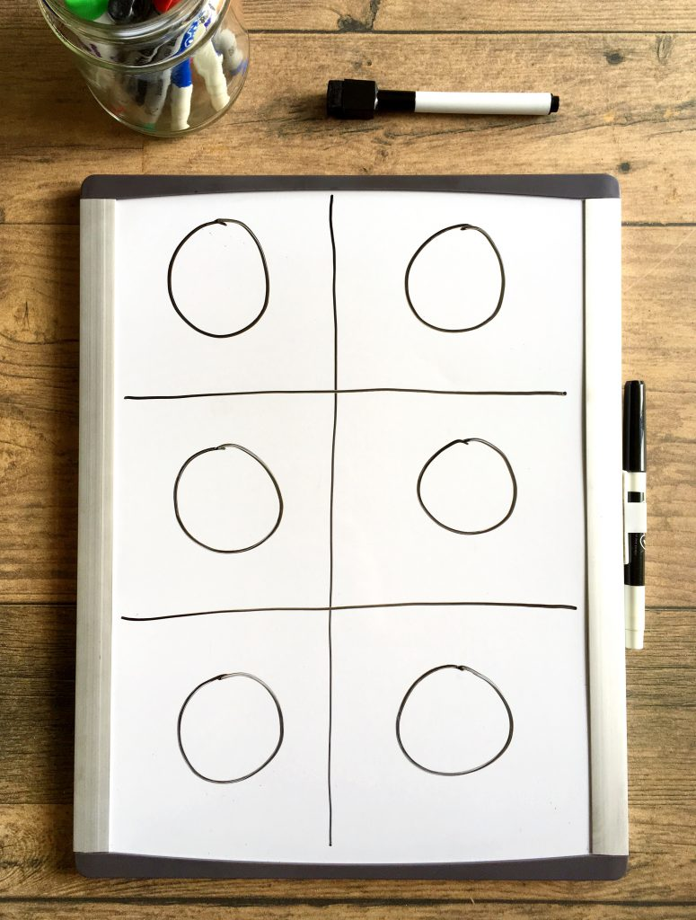 Small whiteboard divided into 6 sections with a circle in each section