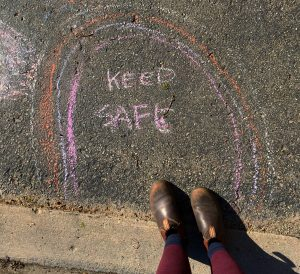 "shoes with chalk art rainbow and ""stay safe"""