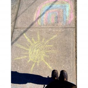 shoes and chalk art of sun and rainbow