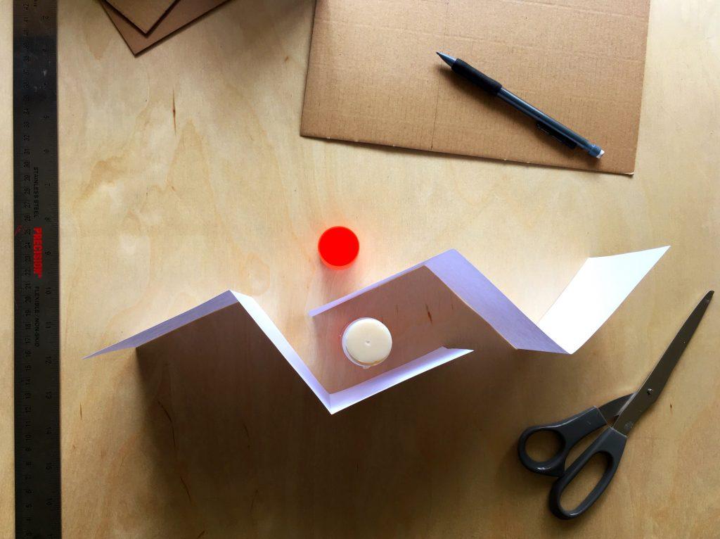 folded paper and glue stick