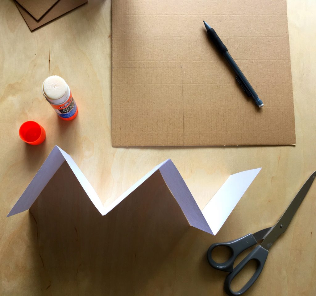 accordion-folded paper and glue stick