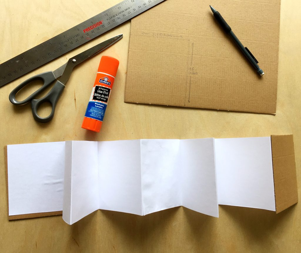 accordion style paper book and cardboard