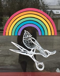 decal of bird and rainbow on shop window