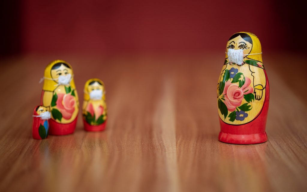 Matryoshka dolls wearing surgical masks