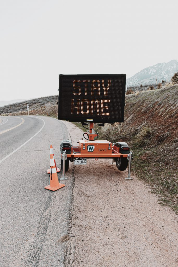 """road sign that says """"stay home"""""""