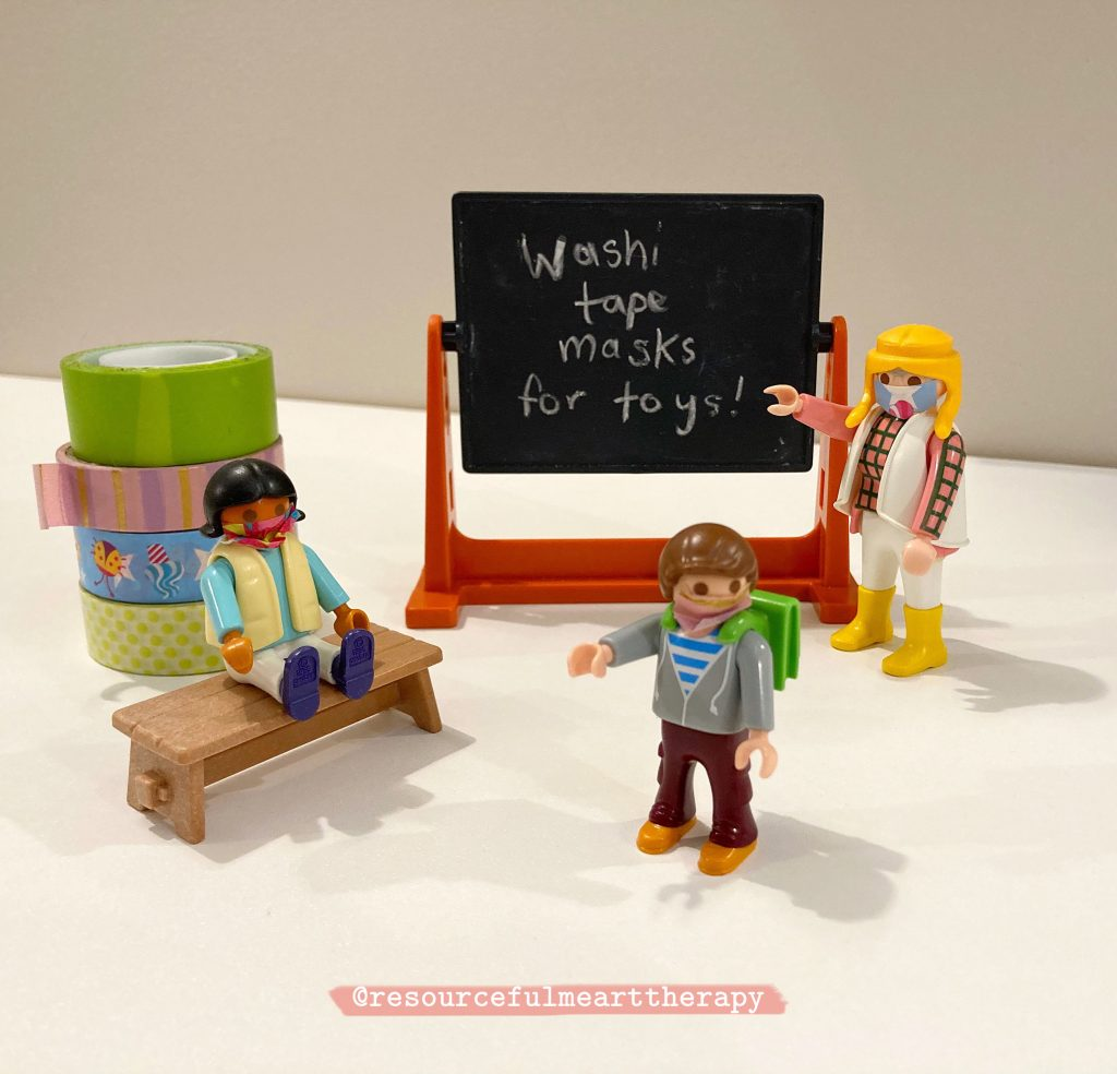 Playmobil toys wearing face masks made of washi tape