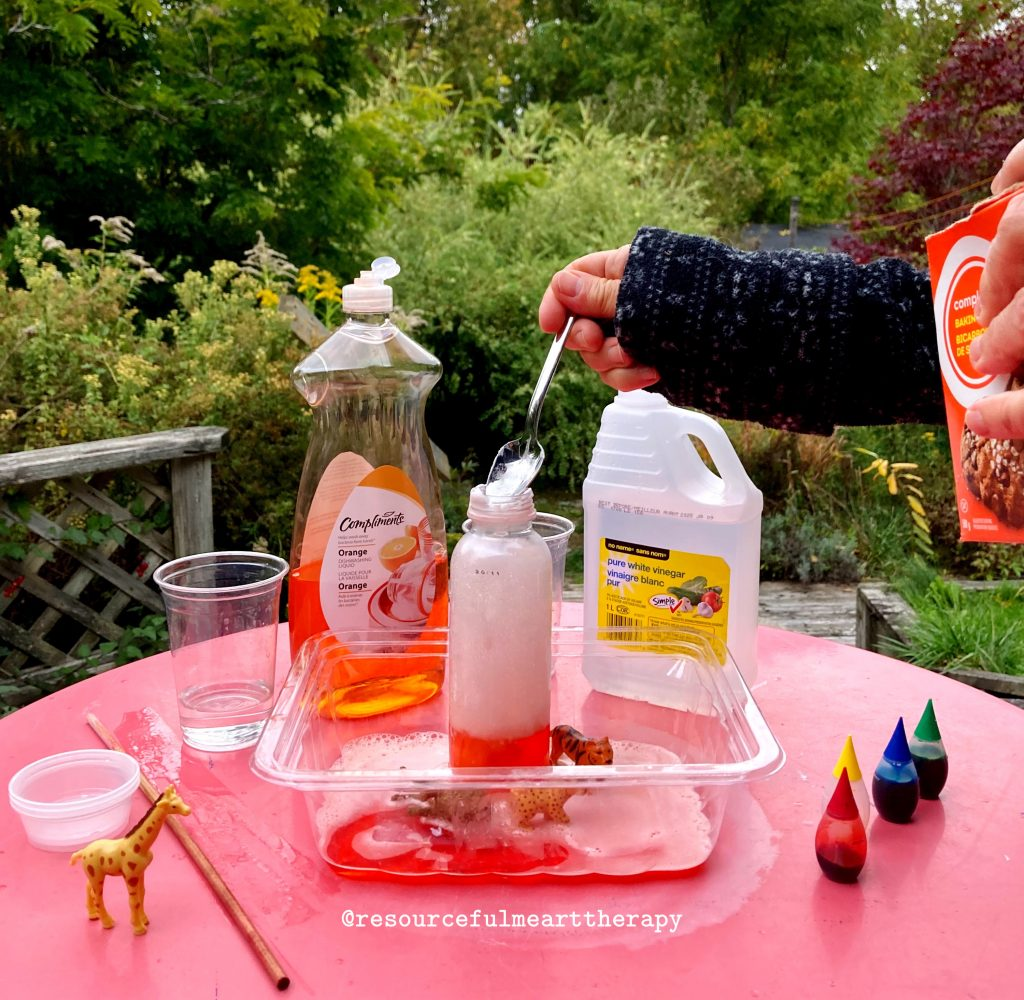 hand dumping a spoonful of baking soda into a plastic bottle