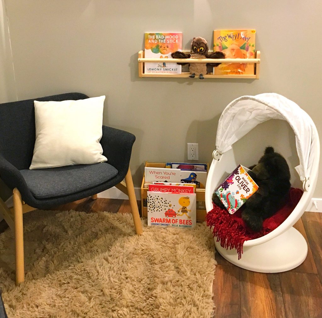 photo of chairs and book shelf with children's books