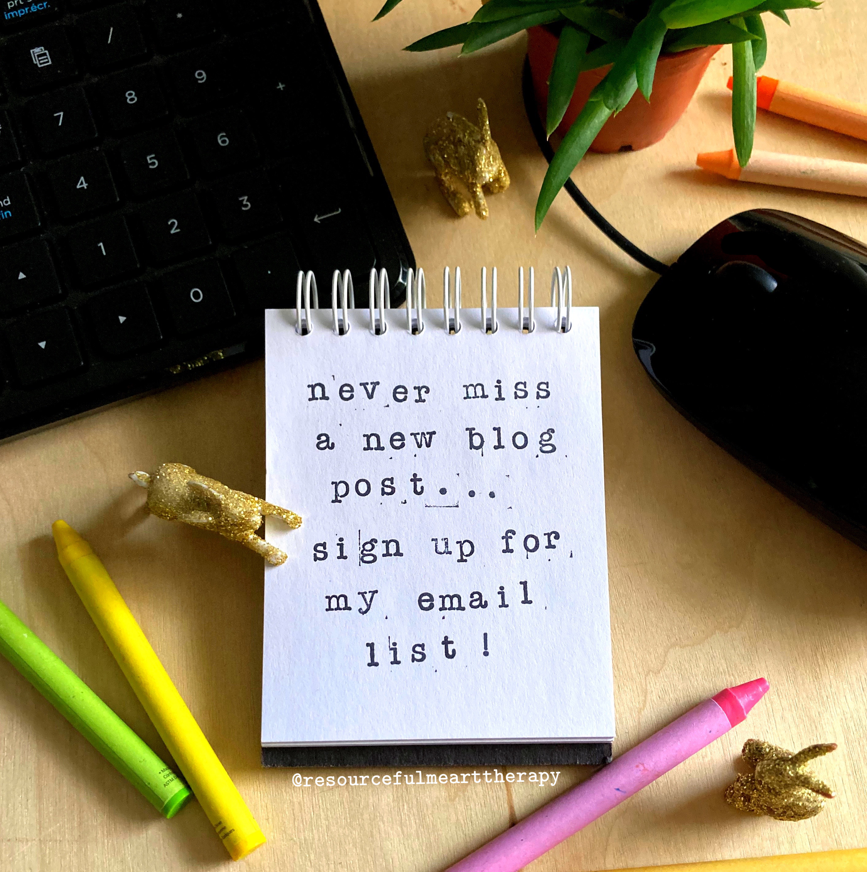 """crayons, plastic bunnies, and a notepad beside a keyboard that says """"never miss a new blog post... sign up for my email list!"""""""