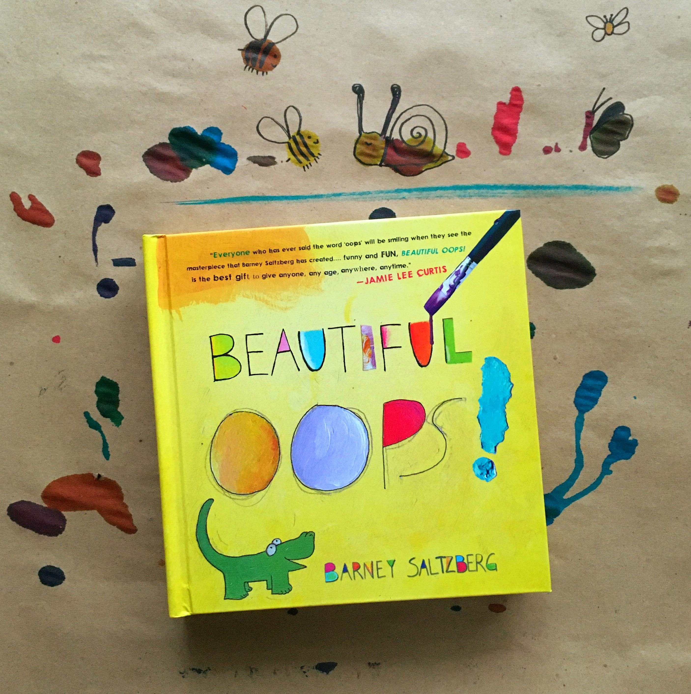 """Photo of the children's book """"Beautiful Oops!"""" by Barney Saltzberg, surrounded by doodles made from paint splatters"""