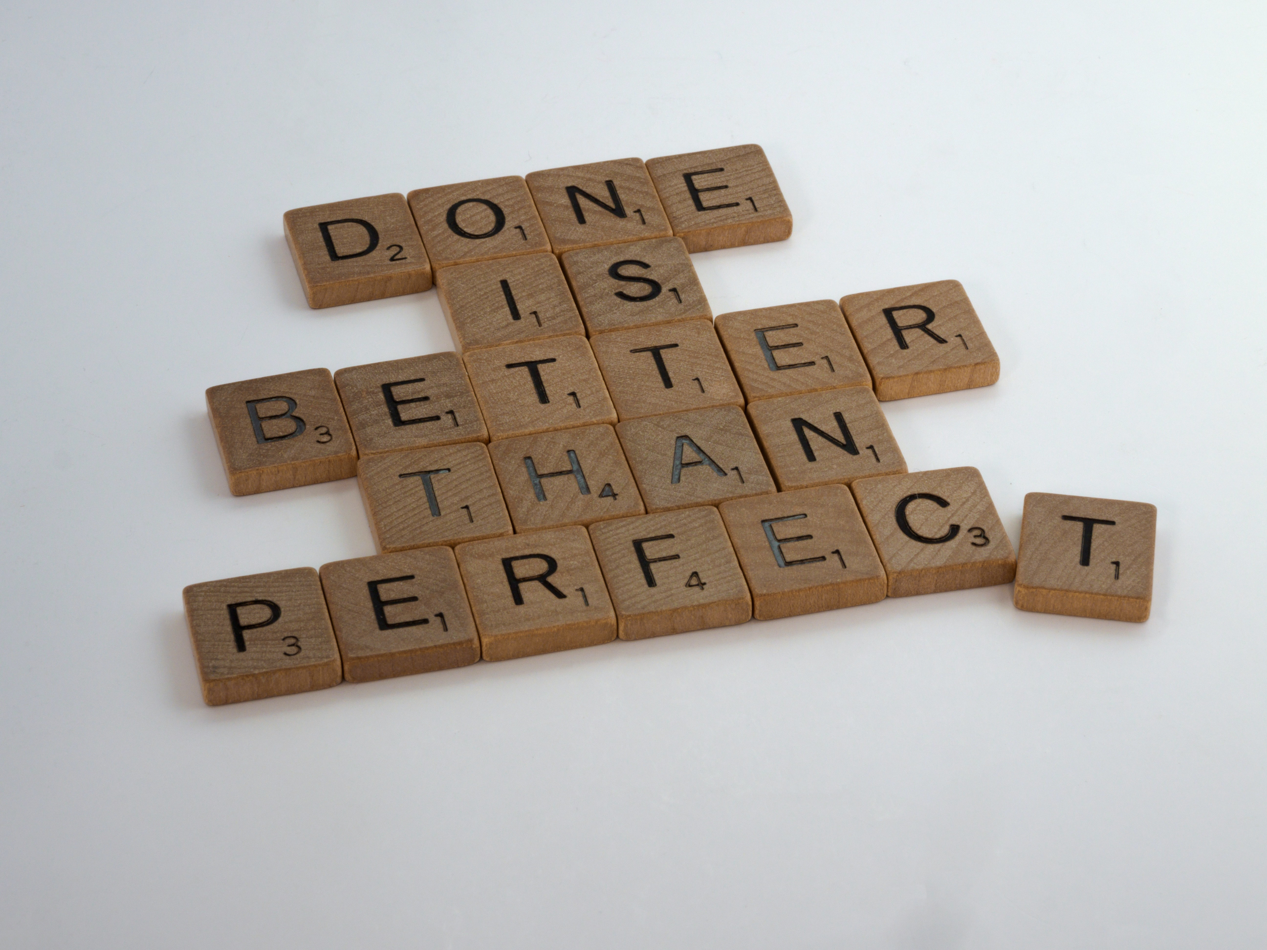 """Photo of scrabble tiles arranged to say """"Done is better than perfect"""""""